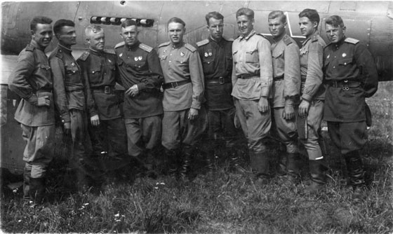 Soviet pilots wearing gymnastyorka uniforms